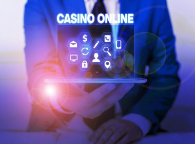 slots games in Canada image of a man holding a laptop with text casino online above it
