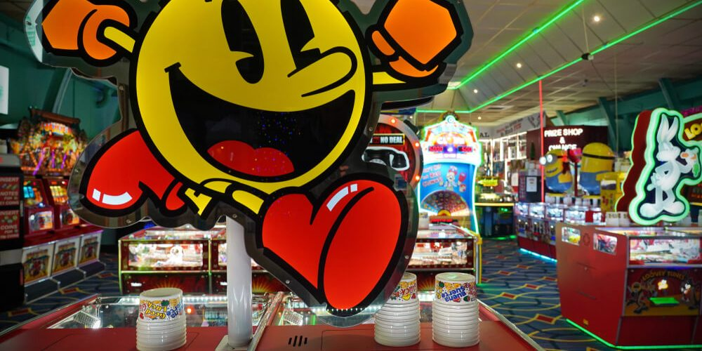online pokies in australia: Slot and coin-op machines and are seen in a seafront amusement arcade.