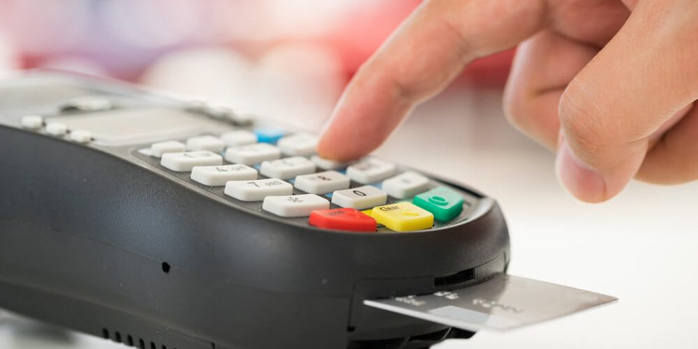 neosurf payment: image of a portable point of sale with credit card inserted