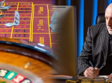 A man develops a strategy for playing in a casino. The person calculates the winning options. Games of chance. Roulette, a table in a casino, and a man next to the money.