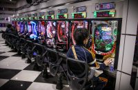 Tokyo, JAPAN - 25 October 2017: Pachinko arcade game and gambling. In Japan, people playing this game like a slot machine. Very colorful and noisy area.