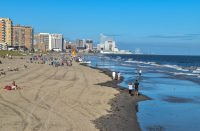 Ventnor City, New Jersey - September,2020: View from above a long beach at low tide from Ventnor City to Atlantic City showing large casino buildings in the distance