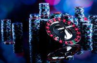 Gambling in casino. Poker chips, roulette wheel.